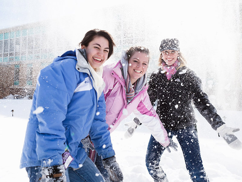 Students frolic in the snow
